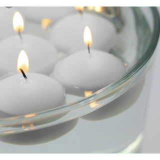 Floating candles 10 X 3,5 cm.