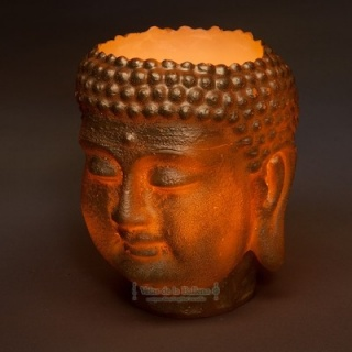Metallized buddha head wax lantern
